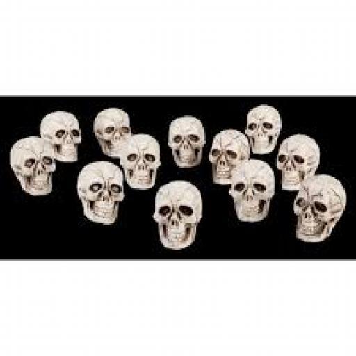 12 Plastic Skulls 2cm each